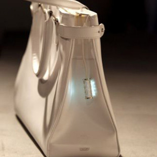 Bag with built-in phone charger