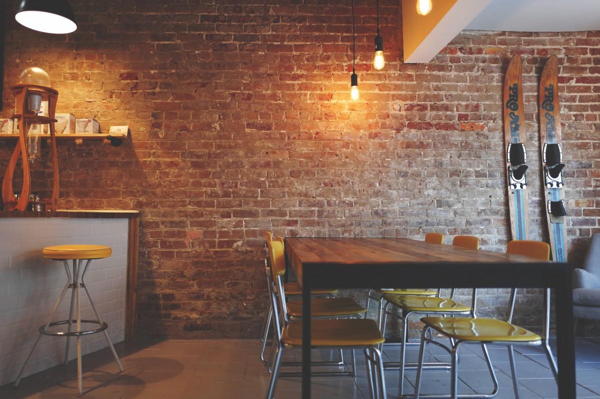 brick_wall_chairs_furniture_interior_design_lights_restaurant_table_wood-1179731